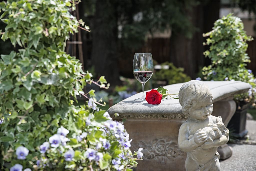 Our relaxing outdoor space is the perfect place to sit back with a glass of wine.
